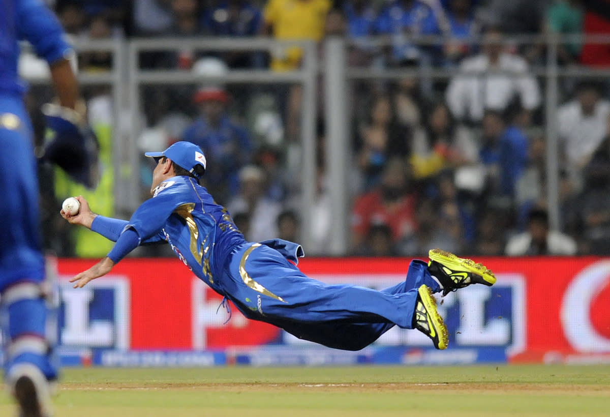 Ricky Ponting captain of Mumbai Indians dives to complete a catch to get Unmukt Chand of Delhi Daredevils out during match 10 of the Pepsi Indian Premier League ( IPL) 2013  between The Mumbai Indians and the Delhi Daredevils held at the Wankhede Stadium in Mumbai on 9th April 2013 ..Photo by Pal Pillai-IPL-SPORTZPICS ..Use of this image is subject to the terms and conditions as outlined by the BCCI. These terms can be found by following this link:..https://ec.yimg.com/ec?url=http%3a%2f%2fwww.sportzpics.co.za%2fimage%2fI0000SoRagM2cIEc&t=1490471968&sig=baCHH.Tcg8ip8p2Nw.SRHA--~C