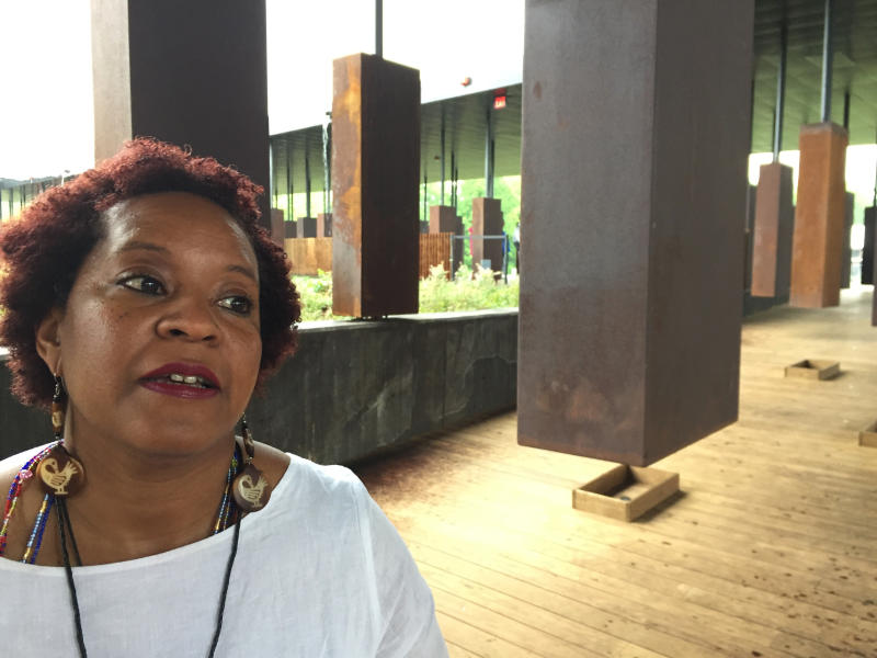 """Toni Battle stands inside a display at the National Memorial for Peace and Justice, a new memorial to honor thousands of people killed in racist lynchings, which opened to the public Thursday, April 26, 2018, in Montgomery, Ala. Battle, who drove from San Francisco to attend said """"I'm a descendant of three lynching victims,"""" her face wet with tears. """"I wanted to come and honor them and also those in my family that couldn't be here."""" (AP Photo/Beth J. Harpaz)"""