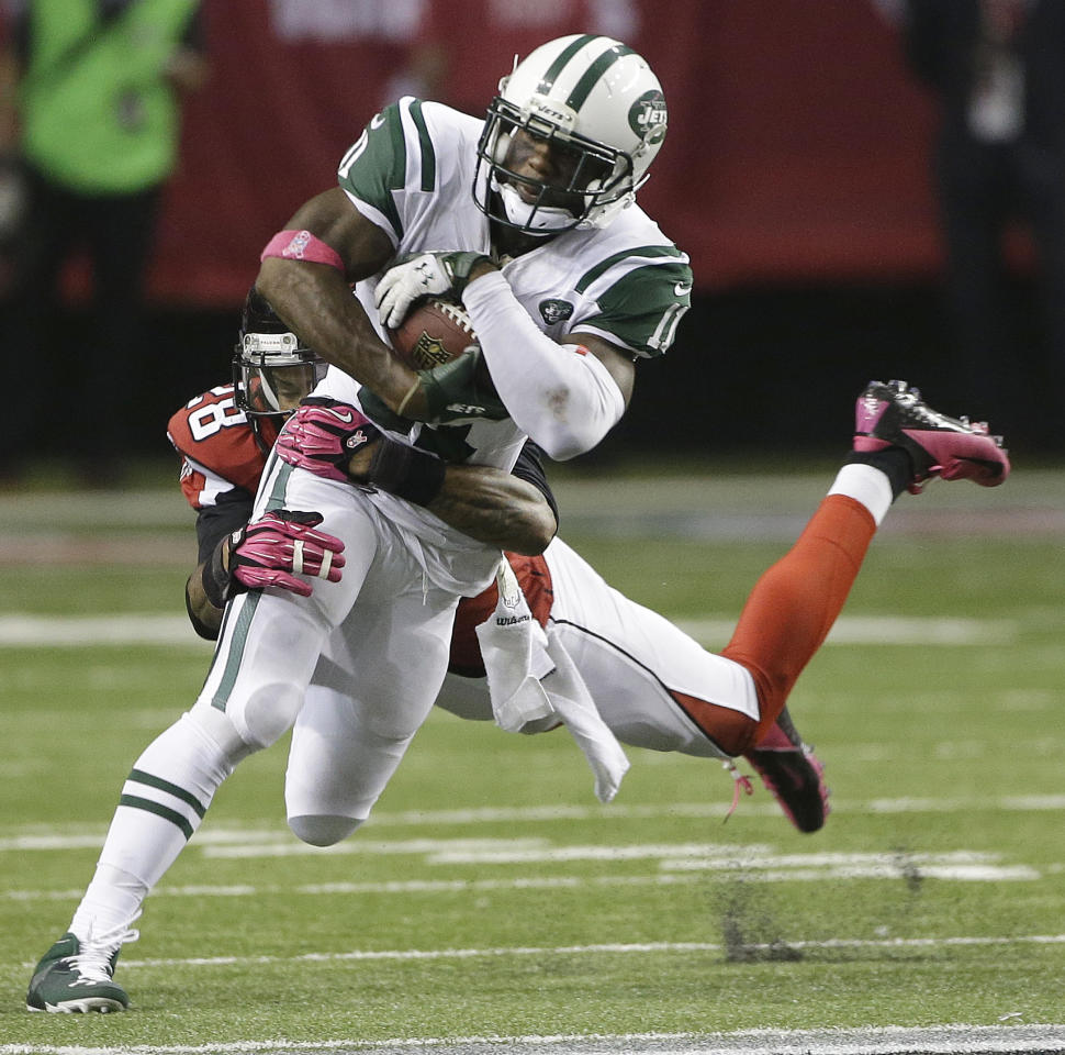Atlanta Falcons free safety Thomas DeCoud (28) tackles New York Jets wide receiver Jeremy Kerley (11) during the second half of an NFL football game, Monday, Oct. 7, 2013, in Atlanta. The Jets won 30-28. (AP Photo/John Bazemore)
