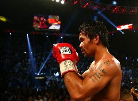 April 9, 2016; Las Vegas, NV, USA; Manny Pacquiao reacts following his victory against Timothy Bradley at MGM Grand Garden Arena. Mandatory Credit: Mark J. Rebilas-USA TODAY Sports  / Reuters  Picture Supplied by Action Images *** Local Caption *** 2016-04-10T044311Z_582036056_NOCID_RTRMADP_3_BOXING-BRADLEY-VS-PACQUIAO.JPG