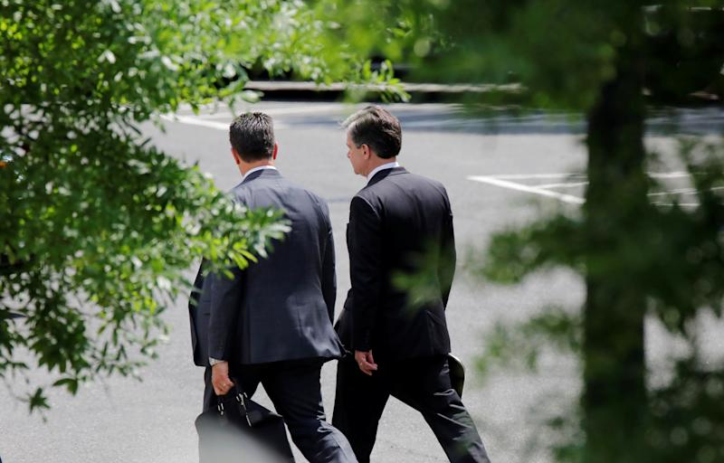 FBI Director Christopher Wray (right) arrives at the West Wing of the White House for a meeting with President Donald Trump on May 21, 2018. (Carlos Barria / Reuters)