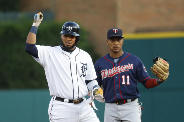 Detroit Tigers' Dawel Lugo reacts to his double, next to Minnesota Twins shortstop Jorge Polanco during the first inning of a baseball game in Detroit, Tuesday, Sept. 24, 2019. (AP Photo/Paul Sancya)