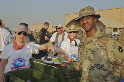 Volunteers Travel to Kuwait to Serve their 100,000th Steak Dinner to Deployed Members of the Minnesota National Guard