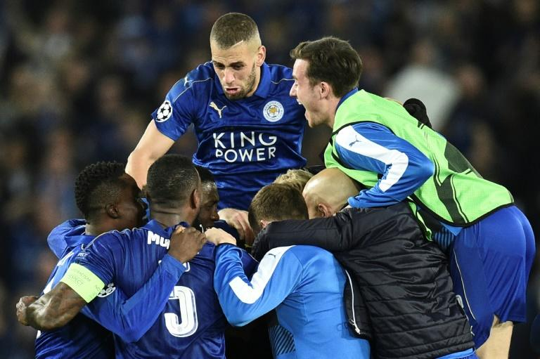 Leicester City players celebrate their dramatic Champions League victory against Sevilla on March 14, 2017