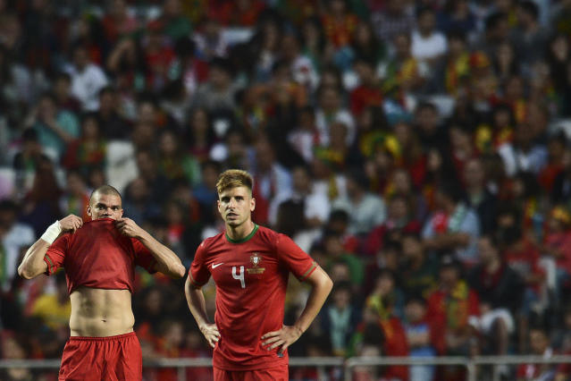 Portugal's defender Pepe (L) and his teammate midfielder Miguel Veloso (R) react after Turkey scored a third goal on June 2, 2012 during a friendly football match at the Luz Stadium in Lisbon in preparation for the Euro 2012 football championship, which will take place in Poland and Ukraine from June 8 to July 1. AFP PHOTO/ PATRICIA DE MELO MOREIRAPATRICIA DE MELO MOREIRA/AFP/GettyImages