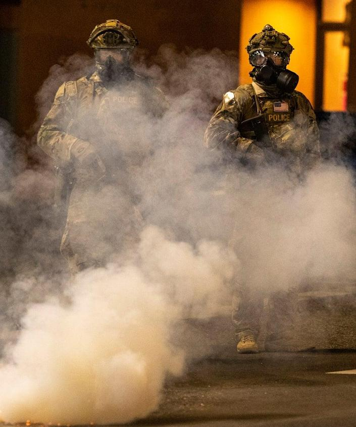 PORTLAND, OR – JULY 21: Federal officers operate amid tear gas while clearing the street in front of the Mark O. Hatfield U.S. Courthouse on July 21, 2020 in Portland, Oregon. The federal police response to the ongoing protests against racial inequality has been criticized by city and state elected officials as President Trump threatens to use Federal law enforcement in other major cities as well. (Photo by Paula Bronstein/Getty Images )
