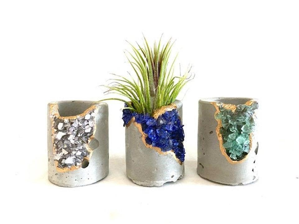 <p>Place these <span>Geode Concrete Planters</span> ($23 each) on your kitchen shelves.</p>