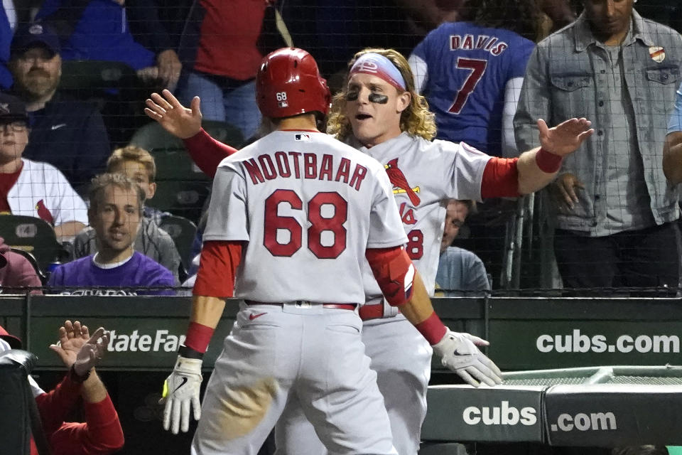 St. Louis Cardinals' Lars Nootbaar (68) celebrates his home run off Chicago Cubs relief pitcher Adam Morgan with Harrison Bader during the seventh inning of a baseball game Friday, Sept. 24, 2021, in Chicago. (AP Photo/Charles Rex Arbogast)