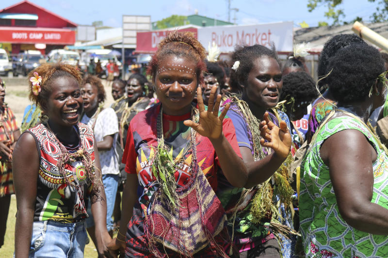 In this Nov. 30, 2019, photo released by Bougainville Referendum Commission (BRC), voters from Selau gather at Buka Market in Bougainville, Papua New Guinea. All across the Pacific region of Bougainville, people have been voting in a historic referendum to decide if they want to become the world's newest nation by gaining independence from Papua New Guinea. (Jeremy Miller/BRC via AP)