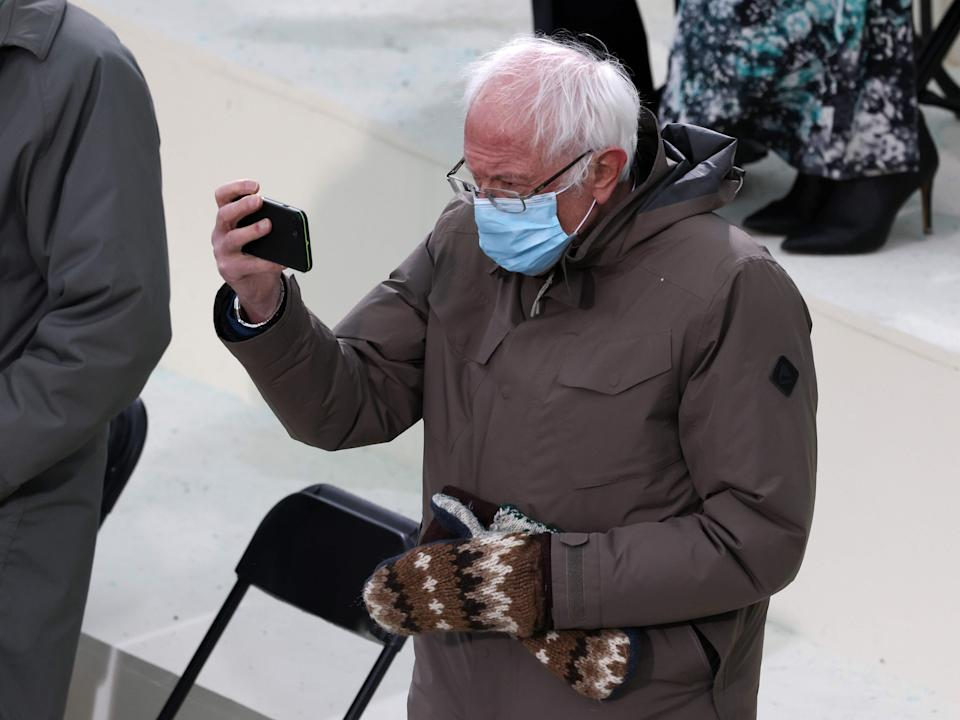 Fans of Vermont senator Bernie Sanders went wild for his unique mittens, which were reportedly made by Jen Ellis, a teacher from Essex Junction, Vermont, as Joe Biden's inauguration ceremony unfoldedPOOL/AFP via Getty Images