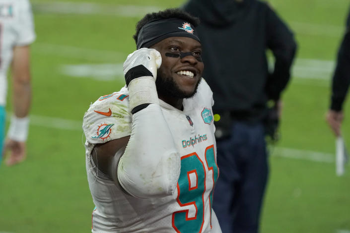 Miami Dolphins defensive end Emmanuel Ogbah (91) celebrates after an NFL football game against the Arizona Cardinals, Sunday, Nov. 8, 2020, in Glendale, Ariz. The Dolphins won 34-31. (AP Photo/Rick Scuteri)