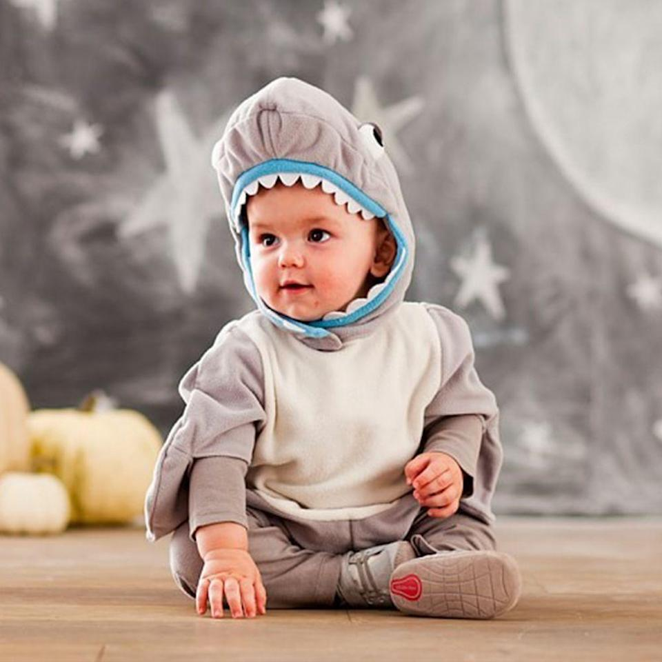 """<p><strong>Pottery Barn Kids</strong></p><p>potterybarnkids.com</p><p><strong>$29.00</strong></p><p><a href=""""https://go.redirectingat.com?id=74968X1596630&url=https%3A%2F%2Fwww.potterybarnkids.com%2Fproducts%2Fshark-onesie%2F%3FcatalogId%3D10%26sku%3D8274326%26cm_ven%3DPLA%26cm_cat%3DGoogle%26cm_pla%3DHalloween%2B%253E%2BBaby%2BCostumes%2B%25280-24M%2529%26cm_ite%3D8274326%26gclid%3DCjwKCAjwps75BRAcEiwAEiACMZtcw7pgMRa-NMft70XPmFQs9gdyHbV9isnLA2zzaY71uuBxAKpvLxoCCAYQAvD_BwE&sref=https%3A%2F%2Fwww.bestproducts.com%2Ffashion%2Fnews%2Fg1709%2Fbaby-halloween-costumes%2F"""" rel=""""nofollow noopener"""" target=""""_blank"""" data-ylk=""""slk:Shop Now"""" class=""""link rapid-noclick-resp"""">Shop Now</a></p><p>Bring the hit song """"Baby Shark"""" to life with your very own mini sea animal. Perfect for your little one, the fabric is soft, comfy, and will feel like they are wearing their pajamas rather than an annoying costume. </p><p>Fair warning: People may spontaneously break out into song, with """"Baby Shark"""" being their only performance.</p>"""