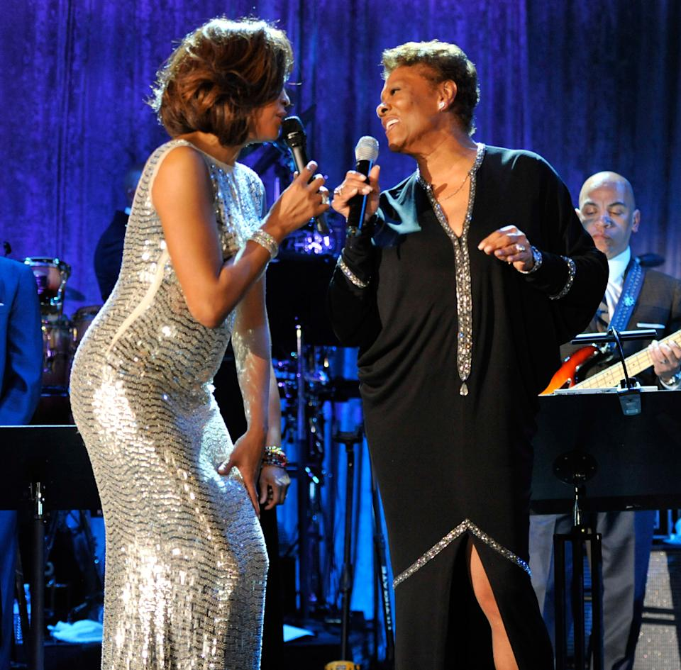 Whitney Houston, seen here performing with Dionne Warwick in 2011, remained close with the Warwick family. (Photo: Getty Images)