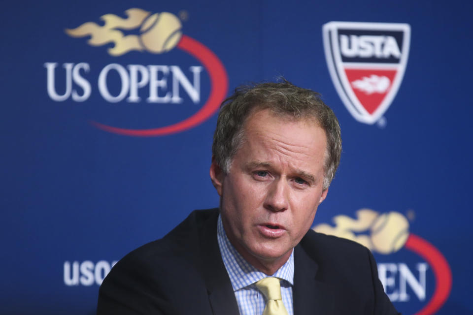 """FILE - In this Sept. 3, 2014, file photo, Patrick McEnroe speaks during a news conference at the U.S. Open tennis tournament in New York. Former U.S. Davis Cup captain Patrick McEnroe says in a video posted on social media that he tested positive for the coronavirus. McEnroe, younger brother of eight-time major champion John, said he did a drive-through test in upstate New York after developing what he called """"minor symptoms"""" about 10 days ago. Patrick McEnroe said: """"The good news is I feel fine. My symptoms have passed. I feel, really, 100 percent."""" (AP Photo/John Minchillo, File)"""