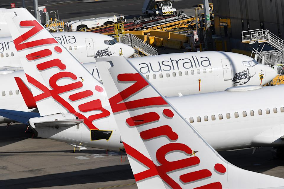 Grounded Virgin Australia planes are seen at Tullamarine Airport in Melbourne.