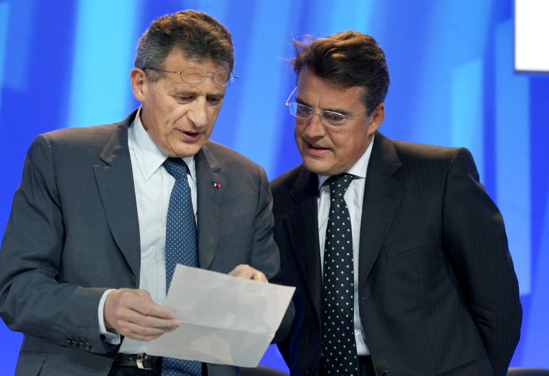 """Chairman of  the holding company Air France-KLM Group Jean-Cyril Spinetta, left, with Air France chairman and chief executive, Alexandre de Juniac, right, attend the company's  Shareholders' meeting in Paris, Thursday, May 31, 2012. France's finance minister personally asked the former head of Air France-KLM to return a euro400,000 ($497,520) payout on Thursday, as the country's new Socialist government tries to rein in executive pay. Pierre Moscovici said on France Inter radio that the money, paid as compensation for a non-compete clause in the executive's contract, """"doesn't go in the direction of decency."""" The French government, which holds a 15.9 percent stake in the Franco-Dutch carrier, will vote against the payment at a shareholder's meeting Thursday, and Air France-KLM CEO Jean-Cyril Spinetta said that the measure seemed likely to be rejected.(AP Photo/Jacques Brinon)"""