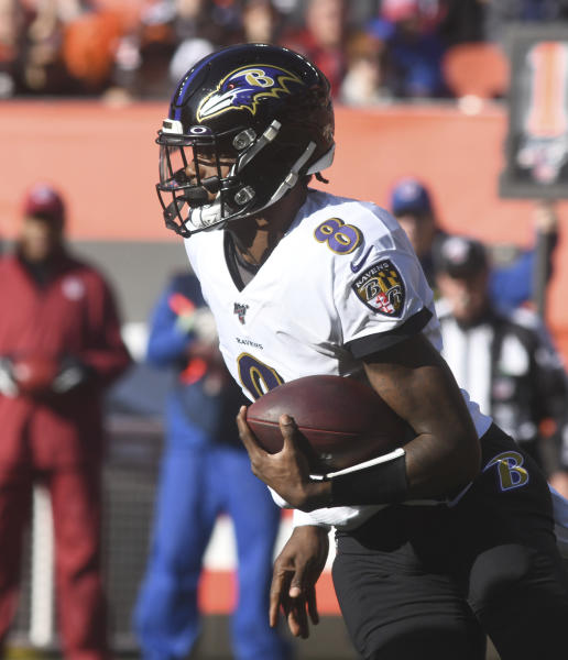 Baltimore Ravens quarterback Lamar Jackson looks for running room on Sunday December 22, 2019, afternoon at FirstEnergy Stadium in Cleveland, Ohio. (Warren Dillaway/The Star-Beacon via AP)