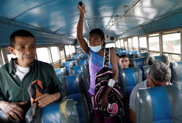 """Aidalis Guanipa, 25, a kidney disease patient, travels by bus after a dialysis session at a dialysis center in Maracaibo, Venezuela. """"I should have been born rich to be able to buy myself a new kidney,"""" said Guanipa. They get by on her 83-year-old grandmother's pension and from sales of homemade sweets. (Photo: Ueslei Marcelino/Reuters)"""