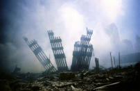 The remains of the World Trade Center stands amid the debris in New York, Tuesday, Sept. 11, 2001. (AP Photo/Alexandre Fuchs)