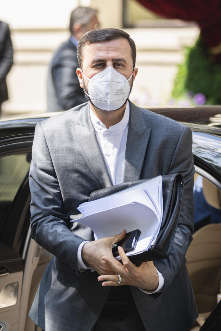 Iran's Governor to the International Atomic Energy Agency (IAEA), Kazem Gharib Abadi, arrives in front of the 'Grand Hotel Vienna' where closed-door nuclear talks take place in Vienna, Austria, Sunday, June 20, 2021. (AP Photo/Florian Schroetter)
