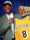 Kobe Bryant, 17, jokes with the media as he holds his Los Angeles Lakers jersey during a news conference at the Great Western Forum in Inglewood, Calif., July 12, 1996. Bryant, a five-time NBA champion and a two-time Olympic gold medalist, died in a helicopter crash in California on Sunday, Jan. 26, 2020. (AP Photo/Susan Sterner)
