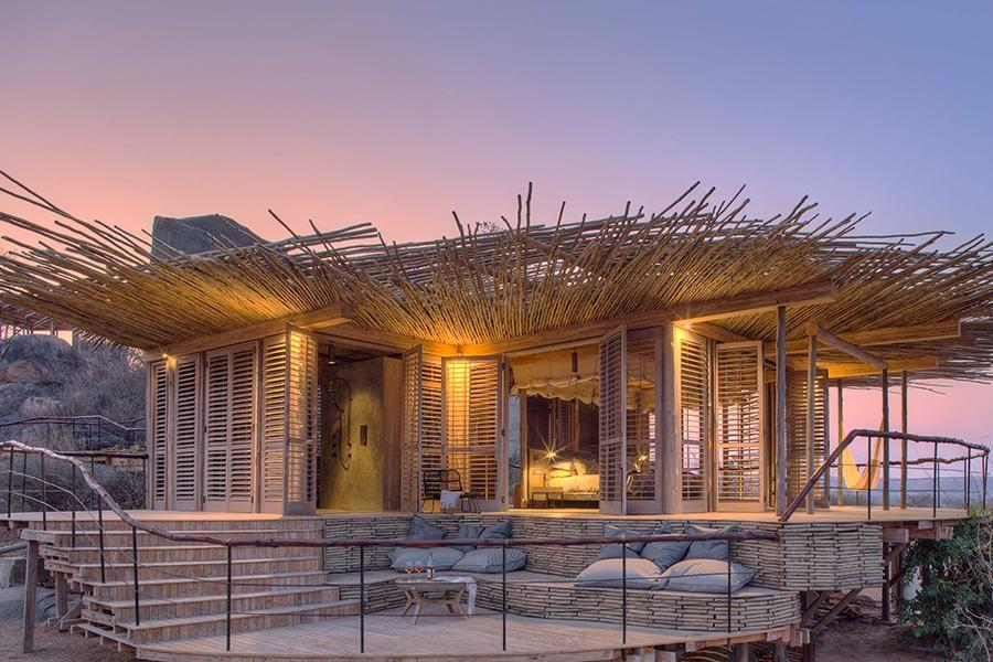 <p>In Ruaha, Tanzania, Jabali Ridge uses traditional wooden slats or shutters for the majority of walls to create a seamless indoor-outdoor feel. It's another feather in the cap of Nicholas Plewman Architects, the mastermind behind some of Africa's most stunning lodges like Sandibe, Arijiju, and Bisate.</p>
