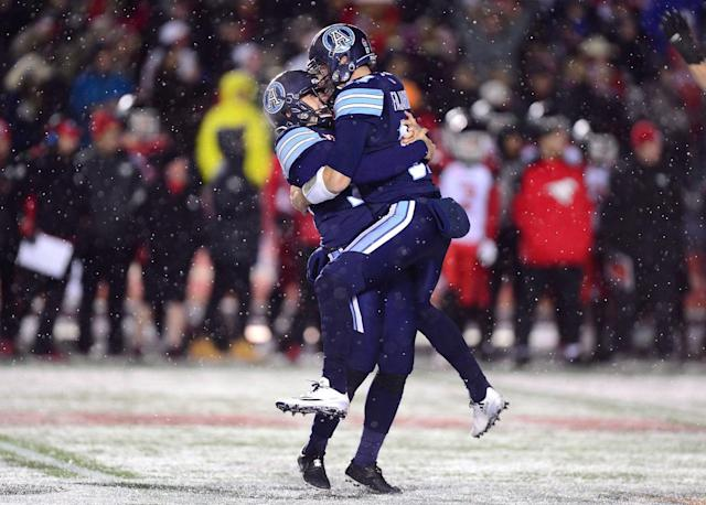 <p>Toronto prevailed over Calgary in a thrilling and snowy Grey Cup final. (Paul Chiasson/CP) </p>