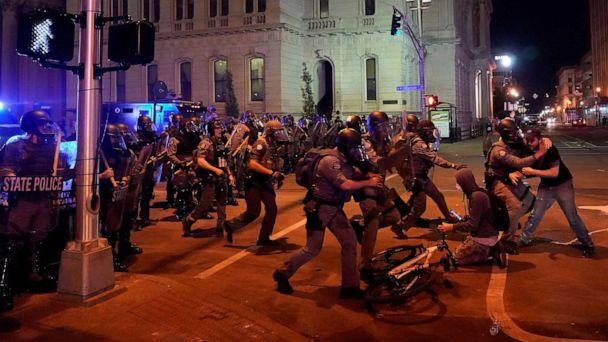 PHOTO: Kentucky State Troopers advance and detain a man during the protest against the deaths of Breonna Taylor by Louisville police and George Floyd by Minneapolis police, in Louisville, Kentucky, June 1, 2020. (Bryan Woolston/Reuters)