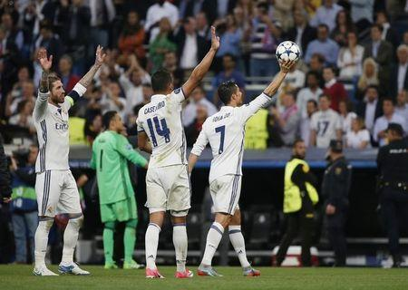 Real Madrid's Cristiano Ronaldo celebrates with the matchball and team mates after scoring a hat trick at the end of the match
