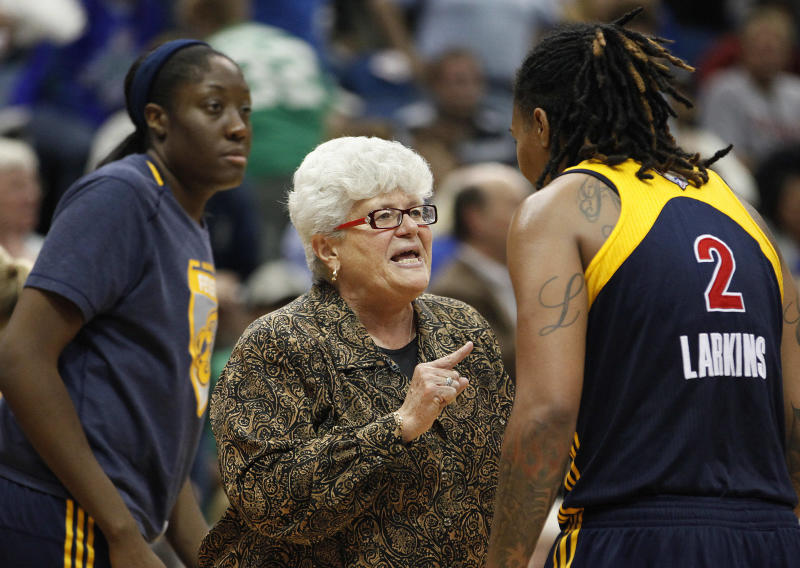 Indiana Fever head coach Lin Dunn talks to forward Erlana Larkins (2) during a timeout against the Minnesota Lynx in the second half of Game 2 of the WNBA basketball Finals Wednesday, Oct. 17, 2012, in Minneapolis. The Lynx won 83-71. (AP Photo/Stacy Bengs)