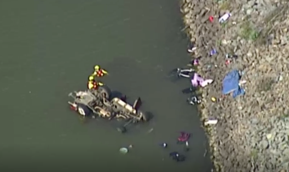 Divers at the scene of a horrific crash in which two children were killed. Source: ABC