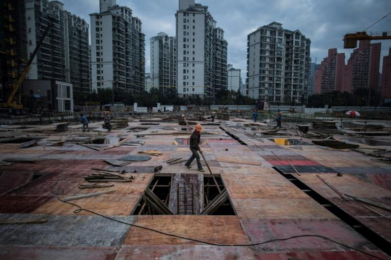 Construction projects, like this one in Shanghai, are mushrooming all over China, but the government has taken a number of measures to cool down red-hot real estate markets amid fears of a potential crash that could affect the broader economy