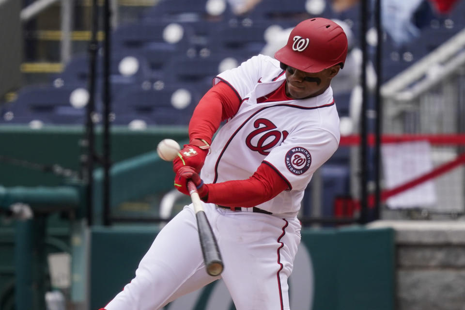 Washington Nationals' Juan Soto hits a sacrifice fly during the fourth inning of a baseball game against the Arizona Diamondbacks at Nationals Park, Saturday, April 17, 2021, in Washington. (AP Photo/Alex Brandon)