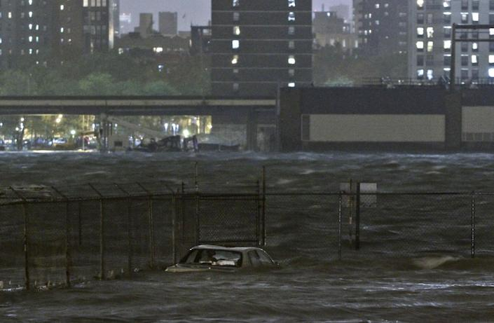 A car is submerged in the Dumbo section of the Brooklyn borough of New York, as the East River overflows during hurricane Sandy, on Monday, Oct. 29, 2012. Authorities warned that New York City and Long Island could get the worst of the storm surge: an 11-foot onslaught of seawater that could swamp lower areas of the city. (AP Photo/Bebeto Matthews)