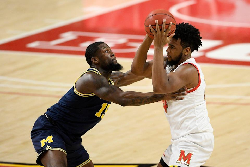 Michigan guard Chaundee Brown defends Maryland forward Donta Scott during the second half Thursday, Dec. 31, 2020, in College Park, Md. Michigan won 84-73.