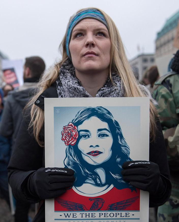 <p>Women and men attend a protest for women's rights and freedom in solidarity with the Women's March on Washington in front of Brandenburger Tor on January 21, 2017 in Berlin, Germany. (Photo by Steffi Loos/Getty Images) </p>