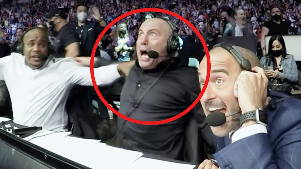 Joe Rogan (pictured middle) reacts during the UFC 261 card.