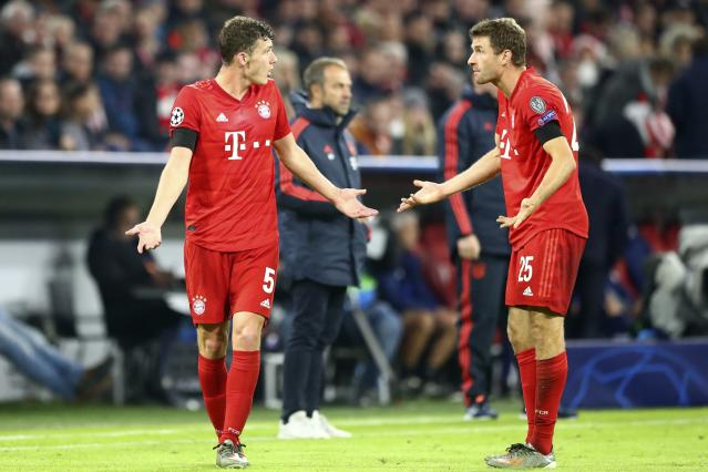 Bayern teammates Benjamin Pavard (left) and Thomas Mueller have a frank exchange of ideas during the Champions League on Wednesday. (AP)