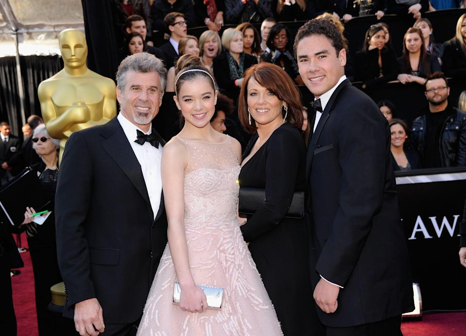 """<h1 class=""""title"""">Hailee Steinfeld with her family (Cheri, Peter, and Griffin) at the 2011 Oscars</h1> <div class=""""caption""""> <em>Left to right: Peter, Hailee, Cheri, and Griffin at the 2011 Academy Awards. Hailee received a Best Supporting Actress nomination for her much-lauded role in True Grit (2010).</em> </div> <cite class=""""credit"""">Getty Images</cite>"""