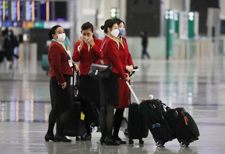 Aircrew arrive at the Hong Kong International Airport, Chek Lap Kok, after a ban on all passenger flights from Britain in bid to stop mutated strain of Covid-19 from reaching the city on December 22, 2020. Photo: Nora Tam