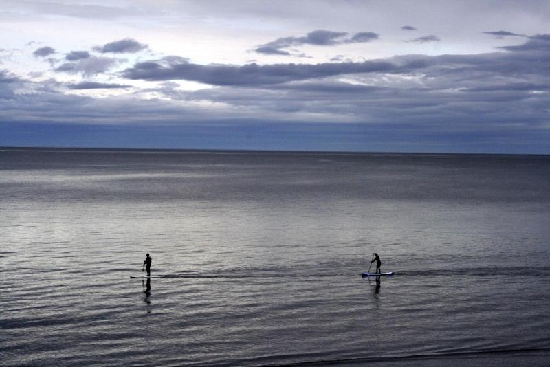 "In this May 25, 2015, photo people use paddle boards in Kachemak Bay in Homer, Alaska. Homer is wading deeper into the national political debate, becoming the latest U.S. city to consider affirming its commitment to inclusion amid concerns about the treatment of immigrants, religious groups, the LGBTQ community and others. The City Council on Monday, Feb. 27, 2017, is expected to weigh a resolution that states Homer will resist any efforts to profile ""vulnerable populations"" and will reject any expressions of fear and hate. (AP Photo/Mark Thiessen)"
