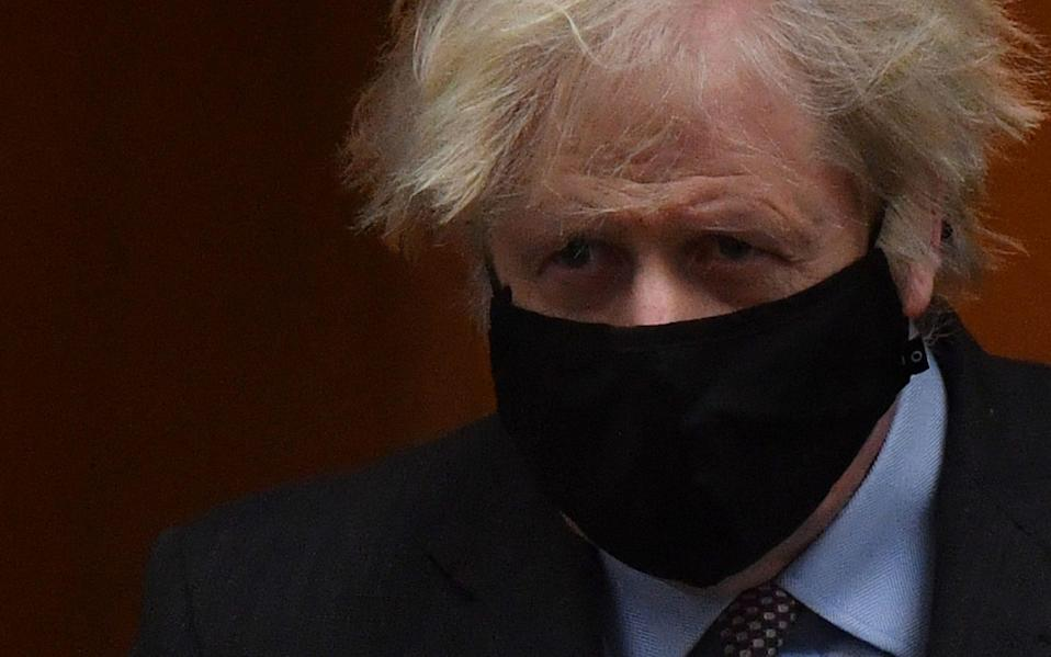Prime Minister Boris Johnson, wearing a face mask, leaves 10 Downing Street  - AFP