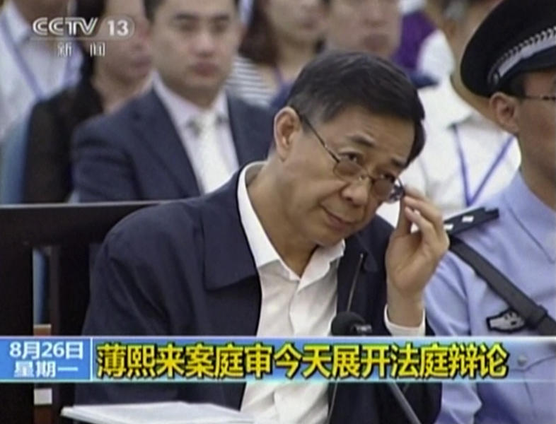 In this image taken from video, former Chinese politician Bo Xilai looks up in a court room at Jinan Intermediate People's Court in Jinan, eastern China's Shandong province, Monday, Aug. 26, 2013. A prosecutor urged a Chinese court Monday to punish disgraced politician Bo with a severe sentence because of his lack of remorse over alleged corruption and abuse of power, in a trial that has offered a glimpse into the shady inner workings of China's elite. (AP Photo/CCTV via AP Video) CHINA OUT, TV OUT