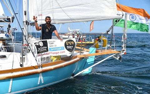 "India's Abhilash Tomy gestures on his boat ""Thuriya"" as he sets off from Les Sables d'Olonne Harbour on July 1 - Credit: JEAN-FRANCOIS MONIER/AFP"