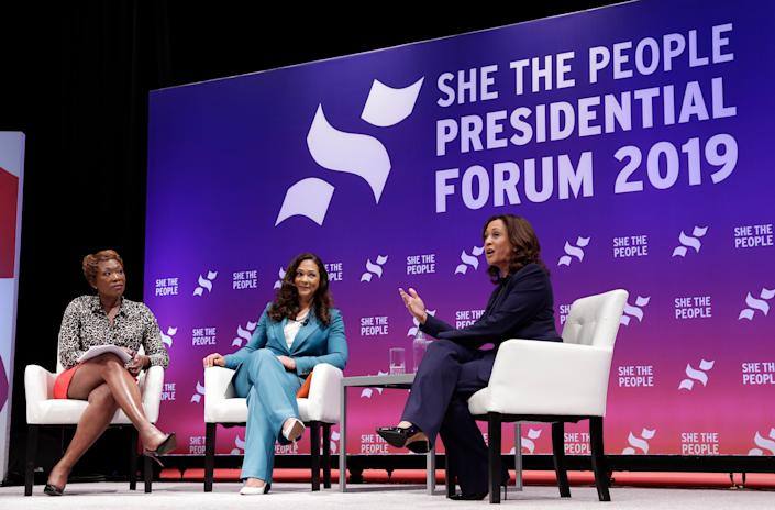 Moderator Joy Reid and She the People founder Aimee Allison listen as Democratic presidental candidate Sen. Kamala Harris, D-Calif., answers questions during a presidential forum held by She The People on the Texas State University campus Wednesday, April 24, 2019, in Houston. (AP Photo/Michael Wyke)