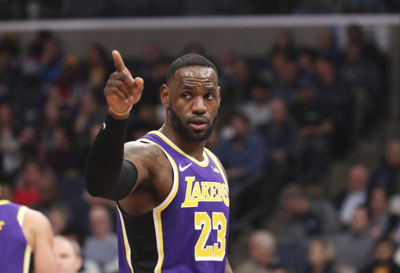 Los Angeles Lakers LeBron James (23) pauses on the court in the second half of a NBA basketball game against the Memphis Grizzlies Saturday, Nov. 23, 2019, in Memphis, Tenn. (AP Photo/Karen Pulfer Focht)