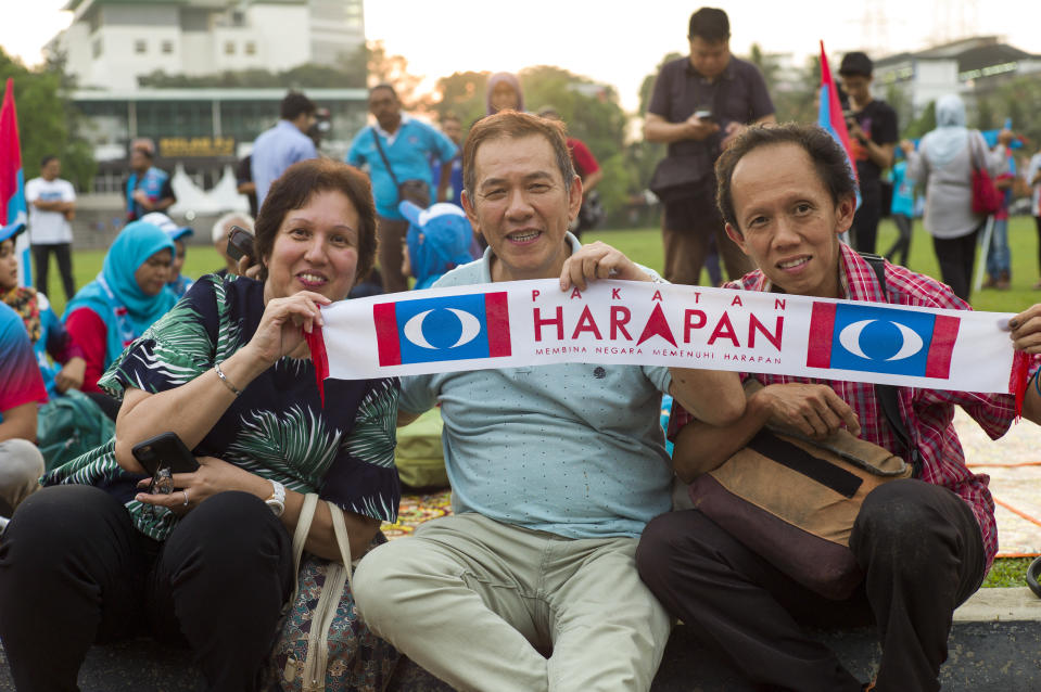 Supporters of Anwar Ibrahim who heads the People's Justice Party (PKR), hold a banner during a solidarity in Petaling Jaya, Malaysia on May 16, 2018. Anwar Ibrahim has been repleased from custody after receiving a pardon from the Malaysia's King Sultan Muhammad V. (Photo by Chris Jung/NurPhoto via Getty Images)