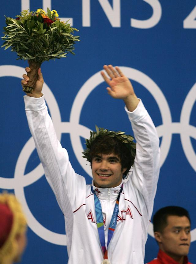 ATHENS - AUGUST 24: Alexandre Despatie of Canada celebrates after receiving the silver medal at the men's diving 3 metre springboard medal ceremony on August 24, 2004 during the Athens 2004 Summer Olympic Games at the Aquatic Centre Indoor Pool at the Olympic Sports Complex in Athens, Greece. (Photo by Daniel Berehulak/Getty Images for FINA)