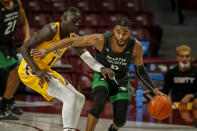 North Dakota guard Caleb Nero (0) works around Minnesota guard Both Gach (11) during the first half of an NCAA college basketball game Friday, Dec. 4, 2020, in Minneapolis. (AP Photo/Bruce Kluckhohn)