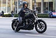 <p>Halle Berry takes her new Harley Davidson motorcycle for a spin around Beverly Hills on Tuesday.</p>